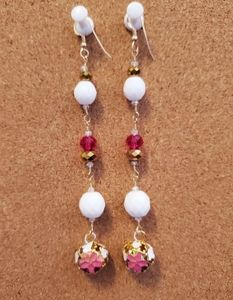 Dangle earrings with pink flower detail